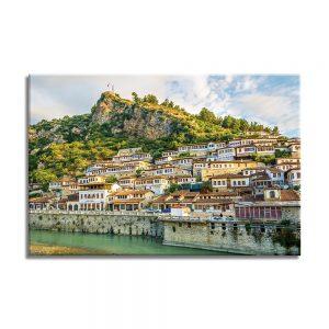 Canvas foto van stad aan de heuvel